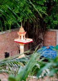 Constant reminders of why we are here...these are tower things that the people daily put food on for Buddha.