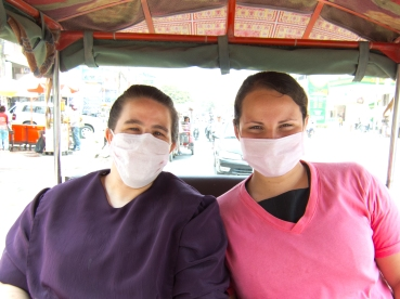 Our tuk-tuk driver stopped and bought us masks to keep out the abundant dust.