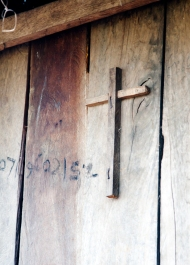 Many of the people of Srey Young are Christians, and I was inspired with this cross on the door of our friend's house.