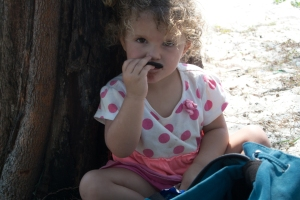 Alaina munching a snack.