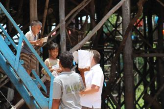 While in the fishing village we handed out Bible story books.